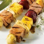 Orange-glazed ham and fruit brochettes