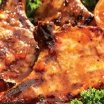 Grilled pork chops with apricot mustard glaze
