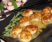 Seared scallops with tarragon- butter sauce